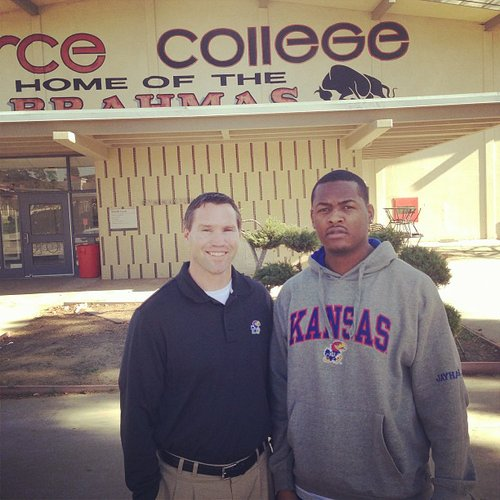 Class of 2013 linebacker Marcus Jenkins-Moore poses with KU linebackers coach Clint Bowen during a recent visit in California. 