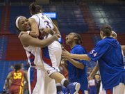 Kansas forward Bunny Williams picks up teammate Angel Goodrich while Lamaria Cole lets out a scream as Kansas players celebrate their overtime victory against Iowa State Wednesday, Jan. 30, 2013 at Allen Fieldhouse. Goodrich hit a three-pointer to send the game into overtime.