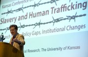 Kansas Gov. Sam Brownback introduces keynote speaker and anti-slavery activist Kevin Bales during Kansas University's first Kansas Conference on Slavery and Human Trafficking in Woodruff Auditorium at the Kansas Union. Thursday's event opened a two-day symposium looking at ways to fight modern-day slavery around the globe.