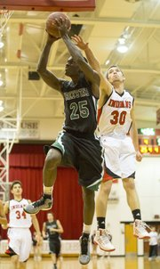 Free State junior Khadre Lane (25) blows past Scott Johnson (30) on his way to the bucket during Free State's game against Shawnee Mission North, Friday, Feb. 1, 2013 in Overland Park.