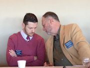 """State Reps. John Wilson, D-Lawrence, and Tom Sloan, R-Lawrence, confer Saturday during the Lawrence Chamber of Commerce&squot;s """"Eggs and Issues"""" meeting."""