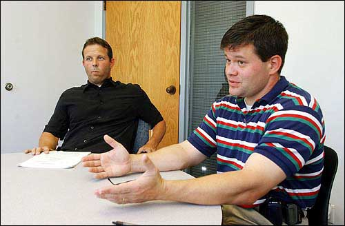 Lawrence Police Detectives Jack Cross, left, and M.T. Brown detail how they got Damien Lewis to confess to the 2002 murders of Pete Wallace and Wyona Chandlee. Lawrence Journal-World file photo.
