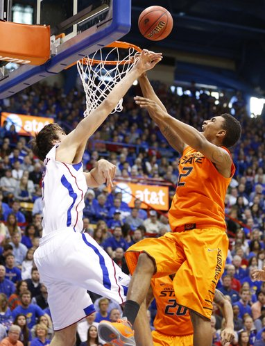 Kansas center Jeff Withey blocks a shot from Oklahoma State forward Le'Bryan Nash during the second half on Saturday, Feb. 2, 2013 at Allen Fieldhouse.