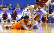 Oklahoma State guard Marcus Smart comes away with a steal from Kansas guard Ben McLemore late in the second half on Saturday, Feb. 2, 2013 at Allen Fieldhouse.