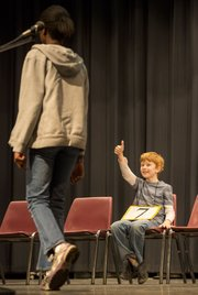 "South Middle School sixth-grader Aidan Pierce gives Abena a thumbs up after she correctly spelled ""triage"" during the Douglas County Spelling Bee on Saturday at Southwest Middle School. Abena won the spelling bee by correctly spelling the world ""stabilizer,"" while Aidan came in second. Both will advance to the regional spelling bee in Topeka."