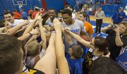 Campers gather around Kansas players Ben McLemore and Rio Adams during the Wilt Chamberlain Special Olympics Kansas Basketball Clinic held Sunday, Feb. 3, 2013 at Allen Fieldhouse.