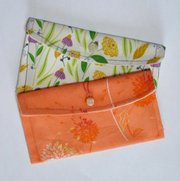 These wallets and other designs by Lawrence illustrator and textile designer Leah Hoelscher will be for sale at the Fresh Squeezed Art Market Feb. 9 in Kansas City, Mo.