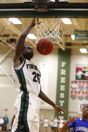 Free State forward Khadre Lane dunks on a breakaway against Leavenworth during the first half on Tuesday, Feb. 5, 2013 at Free State High School.