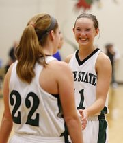 Free State guard Kennedy Kirkpatrick smiles at teammate Scout Wiebe after Wiebe was fouled on a made bucket by a Leavenworth player during the second half on Tuesday, Feb. 5, 2013 at Free State High School.