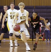 Lawrence High&#39;s John Barbee (22) gets the steal on Shawnee Mission West&#39;s senior Dalton Rose on Tuesday, Feb. 5, 2013, in Overland Park.