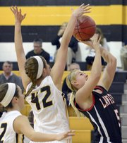Lawrence High's Bri Anderson (5) takes a two against Shawnee Mission West on Tuesday, Feb. 5, 2013, in Overland Park.
