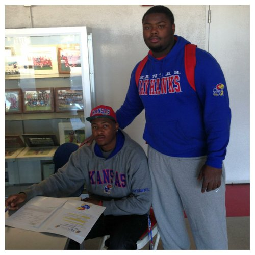 New KU linebacker Marcus Jenkins-Moore (seated) was joined by Pierce C.C. teammate and future KU teammate Marquel Combs at today's signing in California.