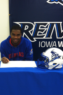 Iowa Western DB Isaiah Johnson after making his commitment to KU official this morning.