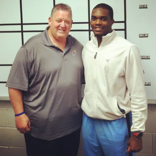 Isaiah Johnson with KU coach Charlie Weis. 