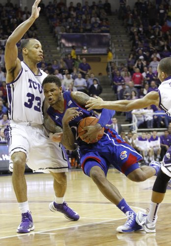 Ben McLemore (23) tries to turn the corner on defender Garlon Green (33) in the Jayhawks 62-55 loss to Texas Christian University, Wednesday at TCU in Ft. Worth, TX.
