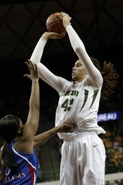 Baylor's Brittney Griner (42) shoots over Kansas' Bunny Williams during the first half of an NCAA college basketball game on Wednesday, Feb. 6, 2013, in Waco Texas. Baylor won 86-45.