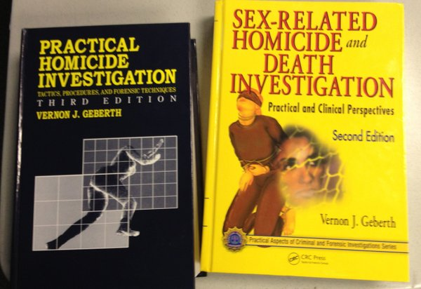Two textbooks on homicide and crime scene investigation used by detectives in the Lawrence Police Department.