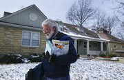 Lawrence mail carrier Tom Carlson makes his way through the West Hills neighborhood on his final day of work Feb. 1 before retiring after 37 years on the job.
