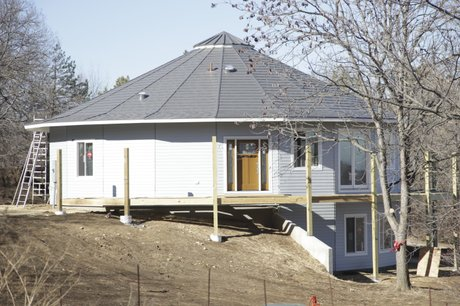 Lawrence couple builds round home for Eco home kits