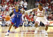 Kansas guard Naadir Tharpe drives around Oklahoma guard Buddy Hield during the first half on Saturday, Feb. 9, 2013 at Noble Center in Norman, Oklahoma.