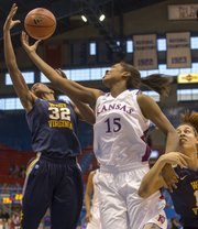 Kansas forward Chelsea Gardner (15) pulls a rebound away from Crystal Leary (32) while holding off Jess Harlee during Kansas' game against West Virginia, Saturday, Feb. 9, 2013 at Allen Fieldhouse.