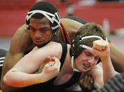 Shawnee Mission Northwest wrestler Laphonso McKinnis, left, competes against Lawrence Free States Jorge Nick Vidoli at the Sunflower League wrestling tournament Saturday, Feb. 9, 2013 at Lawrence High School.