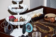 A cute jewelry holder, at right, keeps accessories in view and makes for a nice display.
