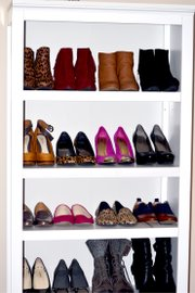 Displaying shoes on a bookshelf puts them in plain sight and keeps them from getting scuffed.