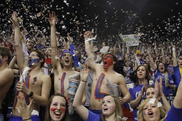 The student section throws confetti on Monday February 11, 2013 in Allen Fieldhouse.