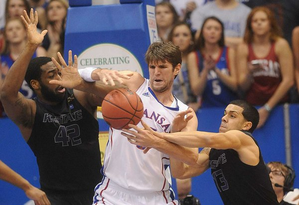 KU's center Jeff Withey (5) looks to control a rebound against KSU defenders Thomas Gipson and Angel Rodriquez (13) as KU hosted the K-State Wildcats on Monday February 11, 2013 in Allen Fieldhouse.