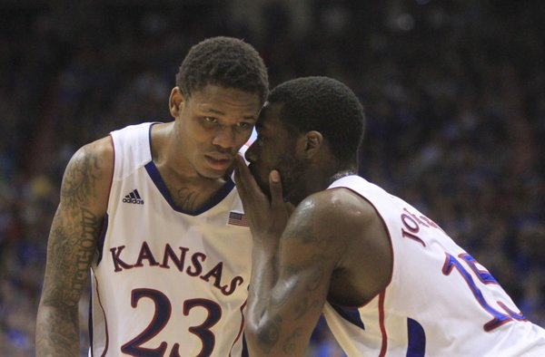 Kansas freshman Ben McLemore (23) and senior Elijah Johnson (15) talk during the end of the second half on Monday February 11, 2013 in Allen Fieldhouse.