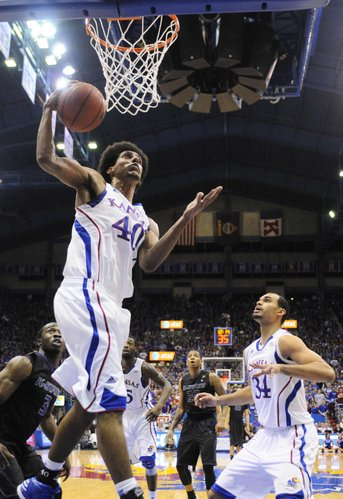 Kansas forward Kevin Young gets a rebound against Kansas State during the first half on Monday February 11, 2013 in Allen Fieldhouse.