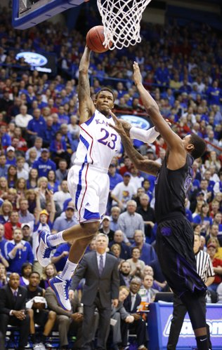 Kansas guard Ben McLemore elevates to the bucket before an intentional foul from Kansas State forward Jordan Henriquez during the first half on Monday, Feb. 11, 2013.