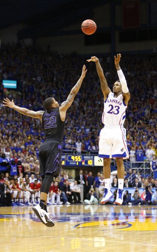 Kansas guard Ben McLemore puts up a three over Kansas State guard Rodney McGruder during the first half on Monday, Feb. 11, 2013.