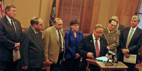 "During the 2012 session, a bipartisan group of representatives and senators introduced a resolution attempting to delay the Jan. 1, 2013 launch of KanCare. The resolution failed, but lawmakers succeeded in persuading the Brownback administration to hold off a year on including in the program long-term services for the developmentally disabled. DD advocates say they will ask this year's Legislature to extend or make permanent that temporary ""carve-out."" Given the large numbers of new legislators following the 2012 elections and the administration's push to expand KanCare, it remains to be seen what will happen. Of the eight legislators shown in this file photo, only three are still serving."