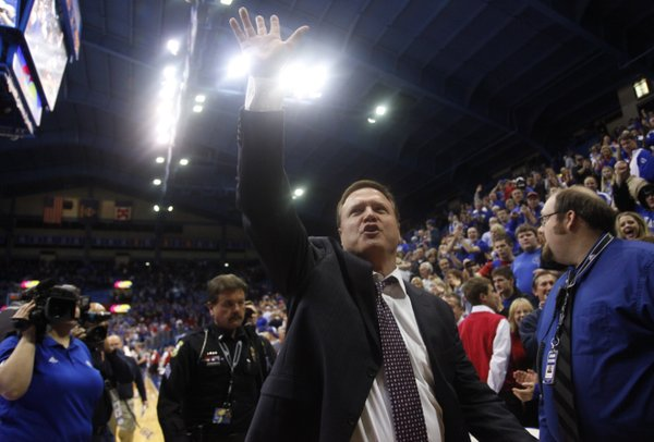 Kansas head coach Bill Self waves to the fans after the Jayhawks' 83-62 win over Kansas State on Monday, Feb. 11, 2013.