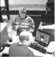 A still frame from surveillance video taken at Lawrence Bank, 100 E. Ninth St., during a robbery Wednesday afternoon about 4:45 p.m. The Lawrence Police Department and the FBI are investigating.