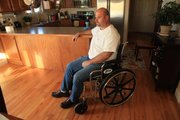 Dennis Wingert, shown in his Lawrence home, is recovering from a December accident at work in which a piece of industrial air-conditioning equipment fell on top of him. The accident left him with a broken left arm, two broken vertebrae, a broken nose, a broken right leg, and a 5-inch laceration from his ear down his cheek. He credits the support of friends and family for the recovery he has made so far.