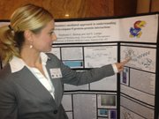 KU Med student Stephanie Bishop displays research on protein inhibitors that can be made into drugs to combat cancer.