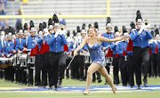 KU Marching Band baton twirler Shannon Livengood, performs before Kansas' football game against TCU Sept. 15, 2012, at Memorial Stadium. Livengood won this year's national collegiate championship.
