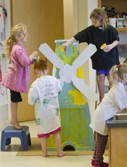Lawrence Arts Center preschoolers paint a windmill that will be one of the holes on the miniature golf course for the Lawrence Public Library Foundation's fundraiser Caddystack.