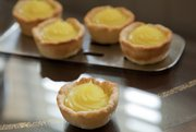 These Lemon-Ginger Tarts with Chocolate can help you keep your sweet tooth in check, one small bite at a time.