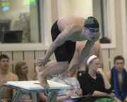 Free State High&#39;s Canaan Campbell gets off the starting block in the 500-yard freestyle during the Class 6A state swimming and diving meet prelims on Friday, Feb. 15, 2013, in Topeka.