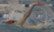 Lawrence High&#39;s Adam Edmonds competes in the 100 back on Friday, Feb. 15, 2013, at the Class 6A state prelims in Topeka.