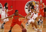 Lawrence High guard Marissa Pope looks to strip the ball from Olathe East guard Valencia Hinton-Scott during the first half on Friday, Feb. 15, 2013 at Lawrence High School. Nick Krug/Journal-World Photo