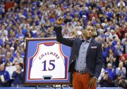 Kansas great Mario Chalmers receives the praise of the fieldhouse crowd as his jersey is retired during halftime against Texas on Saturday, Feb. 16, 2013 at Allen Fieldhouse.