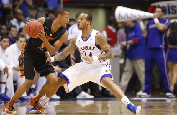 Kansas guard Travis Releford pressures Texas guard Demarcus Holland during the first half on Saturday, Feb. 16, 2013 at Allen Fieldhouse.