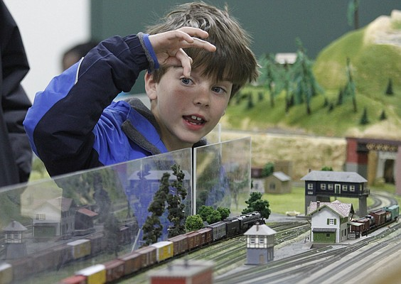 Ian Murphy, 8, Lawrence, counts the number of cars on a train as it passes him by at the 12th annual Lawrence Model Railroad show and swap meet Saturday, Feb. 16, 2013 at the Douglas County Fairgrounds.