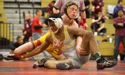 Lawrence High wrestler Caden Lynch tries to bring down Shawnee Mission West&#39;s Aaron Taylor in the 138 pound state regional championship wrestling match, Saturday, Feb. 16, 2013 at Free State.