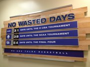 The Tulsa basketball programs goals under coach Danny Manning are spelled out for all to see.
